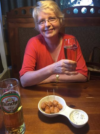 Sillamae, Estonia: My wife at the Krunk Bar and Grill. Fried cheese balls with a garlic dipping sauce.