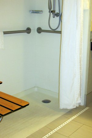 Neptune, NJ: nice way to catch water so there is not water all over the room like many handicalled bathrooms