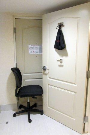 Neptune, NJ: chair used to  prop open heavy bathroom door to heavy for me to open