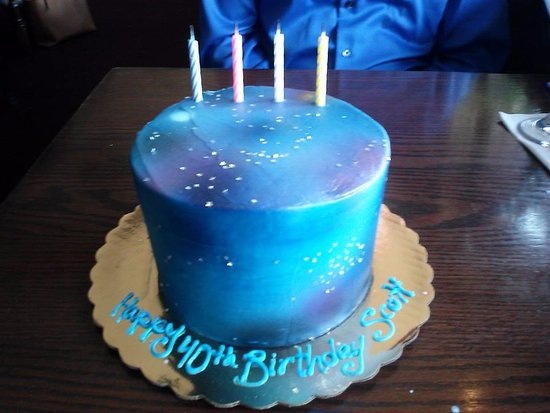 Husband's 40th birthday galaxy cake.   Picture of The Village Bake
