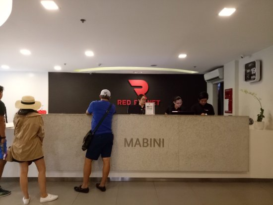 Red Planet Mabini: Photos of lobby, reception and business center, elevator access, room and bathroom