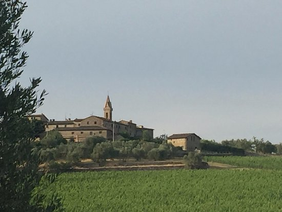 San Gusme and church overlooking vineyards surrounding her