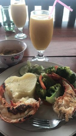 Punta Gorda, Belize: lobster tail served with pineapple garlic butter sauce, steamed veggies, garlic mashed potatoes