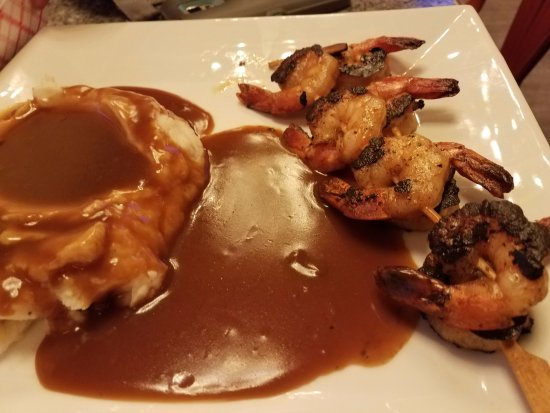 Badlands Saloon and Grille: Burnt Shrimp with Potatoes. $12, maybe more.