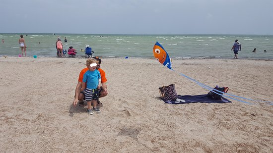 Rockport Beach: Getting their kite on. (See? Plenty of room around us.)