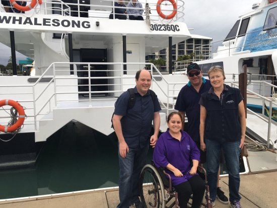 Whalesong Cruises: My husband and I with Captain Jason and his wife Virginia - ramp accessibility = A+