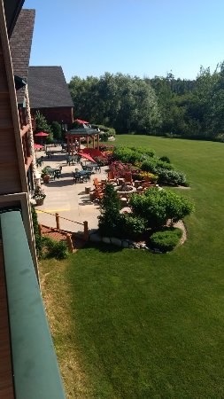 Alanson, MI: View toward ground level patio from our room balcony.