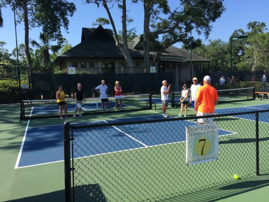 Palmetto Dunes Tennis & Pickleball Center: Mark Anders (orange shirt) leads a clinic for beginners.