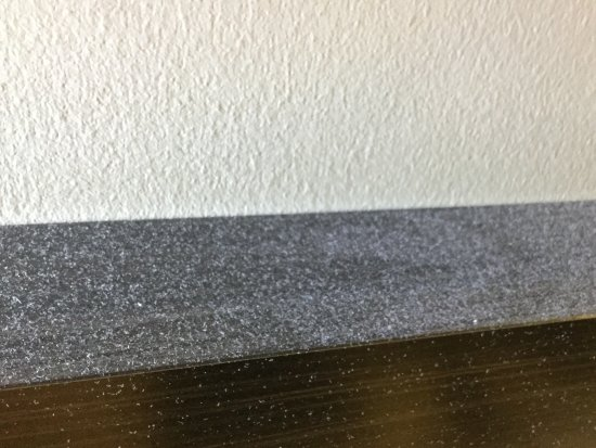Marion, IL: Thick dust on the bed headboard. May look like paint overspray but it was dust....