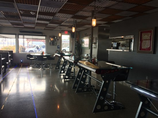 Wings Cafe Enter Featuring Runway Lighting On The Floor And Booths With