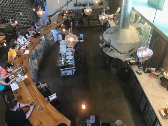 Menomonie, WI: Looking down to the wood fired brick oven and bar.