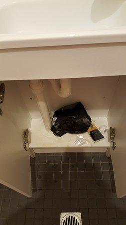 The Albion Hotel: Cupboard under sink