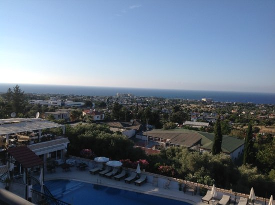 Edremit (Trimithi), Cyprus: View of dining terrace and the pool looking towards the coast