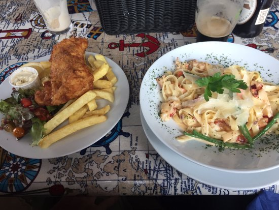 Tigh T.P.: Best Fish and Chips ever-- and Lobster Tagliatelle with TONS of lobster