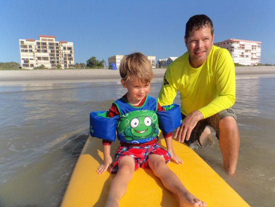Paddling Paradise: 3 year old first time on paddle board and loved it!