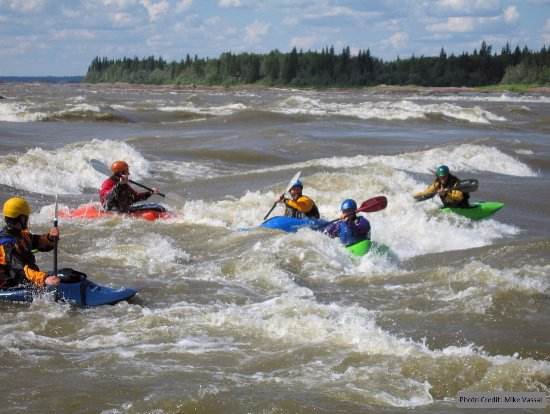"Fort Smith, Canada: Paddlers at the ""Playground"" at Mountain Rapids"