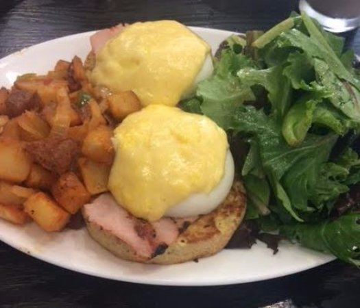 Mineola, NY: Eggs Benedict Poached eggs, Canadian bacon, home fried potatoes, hollandaise sauce, biscuit