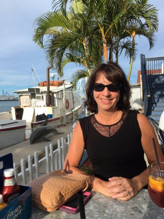 Port Canaveral, FL: Sitting on the patio outside in the blazing sun