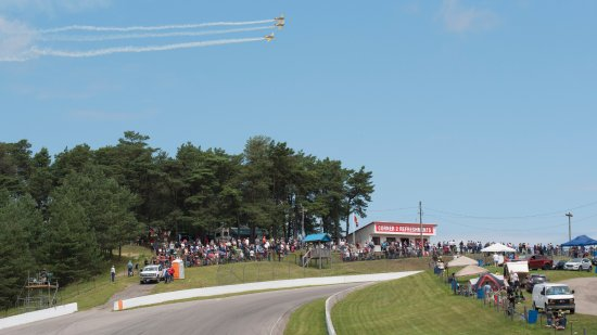 Bowmanville, Canada : We had a small air show before the race started with three planes flying in formation over turn