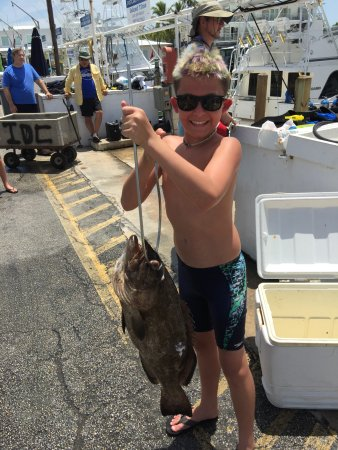 Islamorada Dive Center: I think the stringer weighed as much as he does!