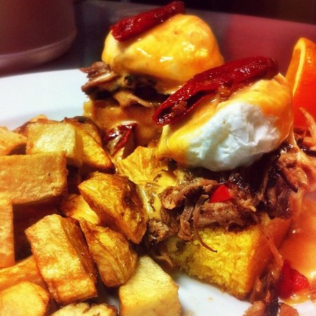 Bleue Coyote Bar & Grill: In house made pulled pork benny served over corn bread.