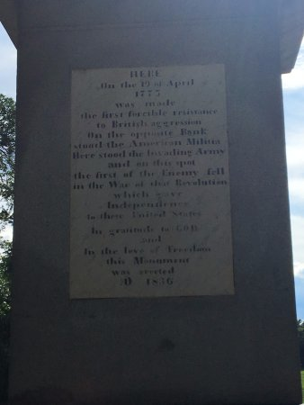 Concord, MA: The plaque on the sculpture at the base of the bridge