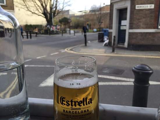 Jose Tapas Bar: having an estrella, looking out at berms street