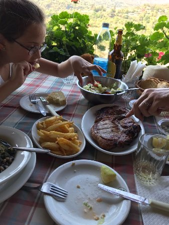 Trimiklini, Cyprus: Served table with pork chop, fries and salad
