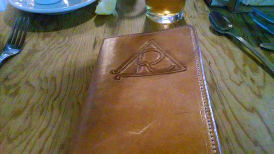 Alpine, TX: Tooled leather folder for the check