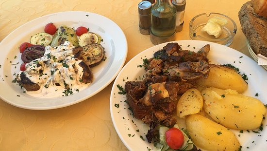 Cetinje Municipality, Montenegro: The traditional plate (on the left) is more than delicious.. I just adored the cherry sauce over