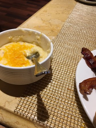 Capriccio Grill : The Cheesy Grits with cheddar cheese added. YUM!