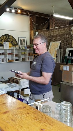 Waterbury, VT: John giving personal service and ringing out a sale.