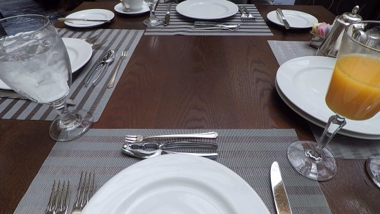 Garden Court Place Settings And Orange Juice