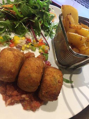 Walkington, UK: Beautiful Fish Cakes with Chips, Salad, and a Salsa Sauce.