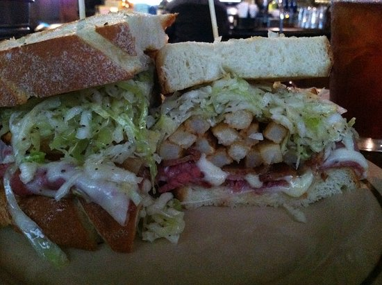 Broderick Restaurant and Bar: Piled high with fries Reuben Sandwich!