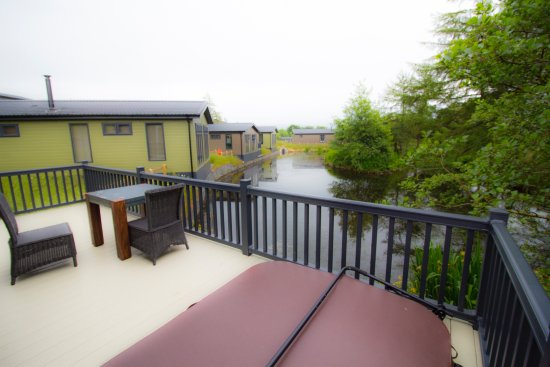 Enjoyable Deck Area With Covered Hot Tub Overlooking Pond Picture Of Home Interior And Landscaping Fragforummapetitesourisinfo