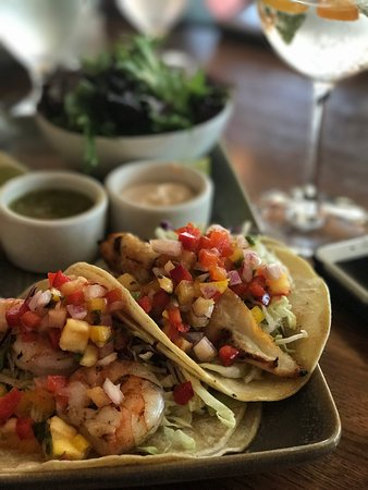 Lafayette, CA: Outstanding fish and prawn tacos with fresh minced mango.  Renowned Cooperage G&T with floral ac
