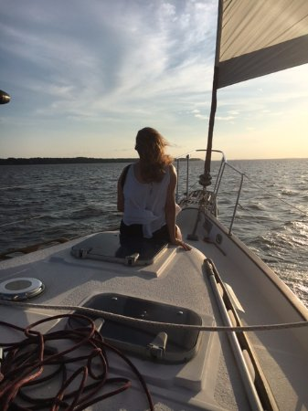 Manteo, NC: Beautiful woman riding on the bow of the Moonshadow.
