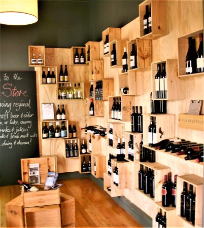 Talbot, Australia: This is the new wine display. Effective because it is well laid out using wine boxes for shelves