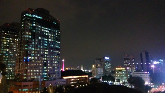 Take's Mansion: Overlooking to Jakarta's night scenery