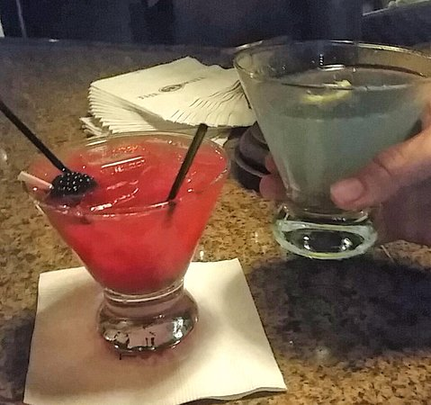 The Driskill: A Batini in red, at the bar. Cheers!