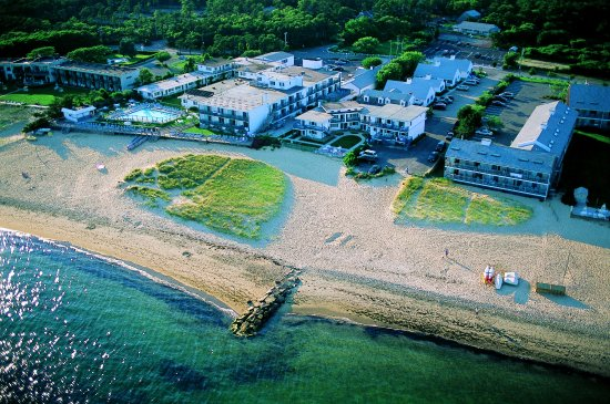 Blue Water on the Ocean: Aerial view of resort and private beach