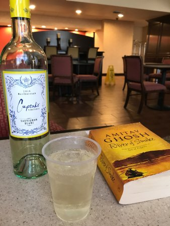Sulphur Springs, TX: relaxing with some wine and a good a book.