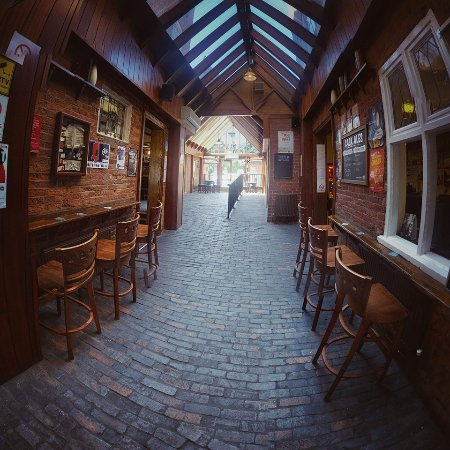 The Three Tuns: This is the old cobble stoned pathway for the dray, now completely under cover.