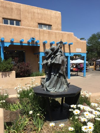 Taos, NM: Sculpture with Farmer's Market in background