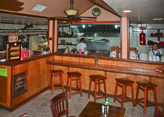 Chokoloskee, FL: Sit at the bar and watch us prepare your food.