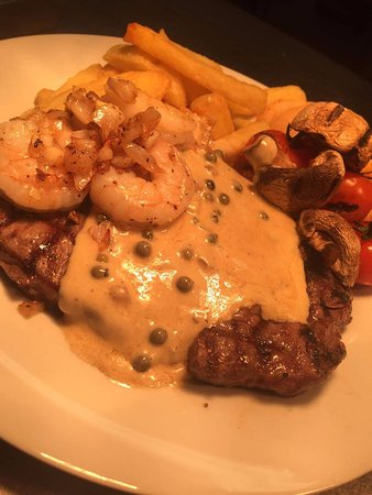 Dumfries and Galloway, UK: Scotch ribeye steak with peppercorn sauce & king prawns