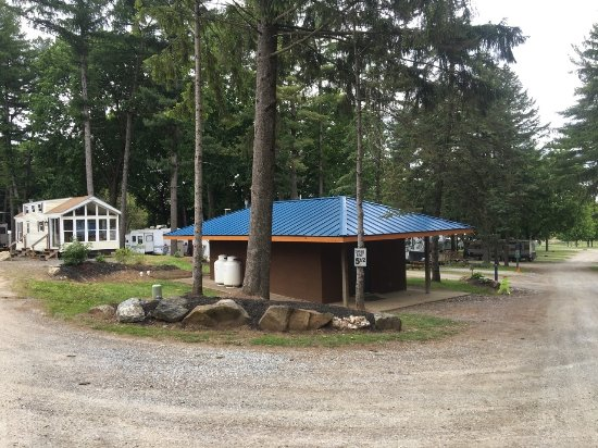 Roamers' Retreat Campground: Upper bathhouse. Site 36 rental Park model to the left