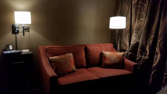 Seymour, IN: Couch with side lamps in room. Comfortable and relaxing.