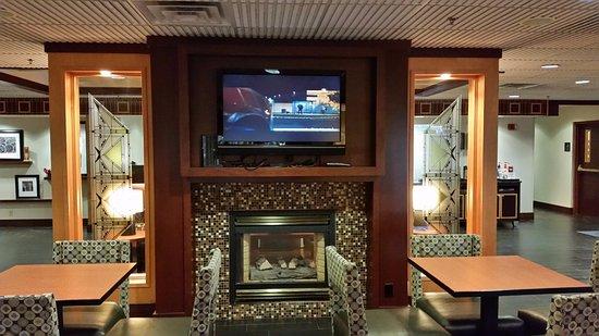 Seymour, IN: Sitting area in lobby. Fireplace.